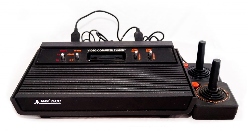 Atari 2600 with two joysticks on a white background.