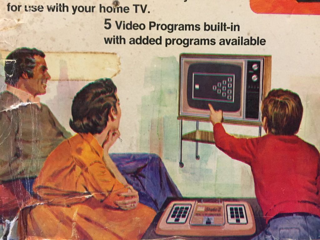 Box art for the RCA Studio II videogame console, featuring a family gesturing at a TV